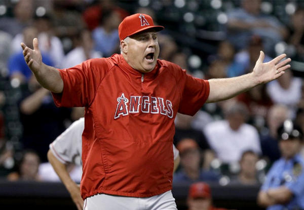 Angels Manager Mike Scioscia questions the umpires on a Houston Astros pitching change.