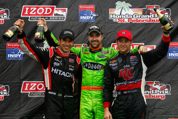 James Hinchcliffe of Canada, driver of the #27 GoDaddy.com Andretti Autosport Dallara Chevrolet stands on the podium with second placed (L) Helio Castroneves of Brazil, driver of the #3 Hitachi Team Penske Chevrolet and third placed (R) Marco Andretti driver of the #25 RC Cola Andretti Autosport Chevrolet, following his victory in the IZOD IndyCar Series Honda Grand Prix of St Petersburg on March 24, 2013 in St Petersburg, Florida.
