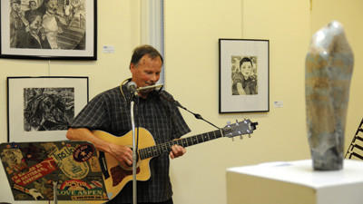 Randy Myers, art teacher at Somerset Area High School, provided music during the opening of an art exhibit featuring the work of Somerset County teachers  held at the Philip Dressler Center for the Arts in Somerset Friday night. Myers, who is showing various pieces in the exhibit, has been working with pottery for more than 30 years.
