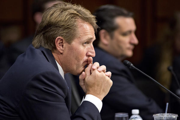 Sen. Jeff Flake (R-Ariz.), left, and Sen. Ted Cruz (R-Texas) listen as the Senate Judiciary Committee meets in a markup session to examine proposed changes to immigration reform legislation, on Capitol Hill in Washington.