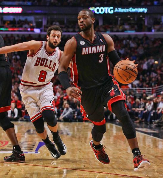 Miami Heat shooting guard Dwyane Wade (3) drives past Chicago Bulls shooting guard Marco Belinelli (8) during the second quarter in game three of the second round of the 2013 NBA Playoffs at the United Center.