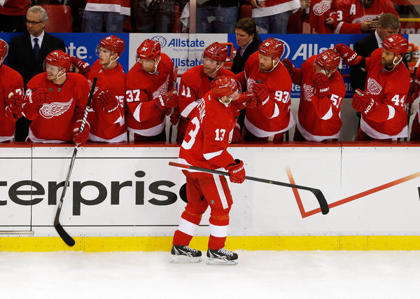 Pavel Datsyuk celebrates his first-period goal with his Red Wings teammates on the bench.