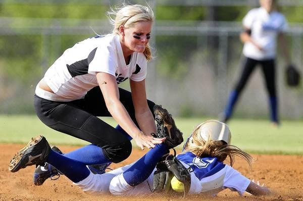 Rob Ostermaier/Daily Press Photo Karley Allen of New Kent tags Allie Nowak of Smithfield as she tries to steal second during the sixth inning Friday at New Kent.