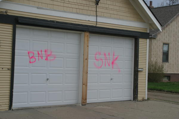 Buildings, vehicles and signs were spray-painted sometime during Thursday night and Friday morning in southeast Aberdeen. American News Photo by Scott Feldman