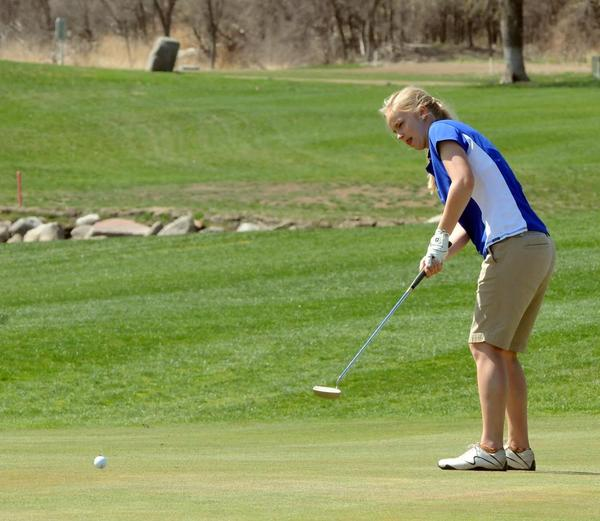 Aberdeen Central's Kayla Krueger putts during Friday's Pierre Invitational. Krueger finished 11th while the Golden Eagles took second in the team standings.