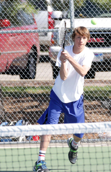 Aberdeen Central's Dillon Prissel follows through on a backhand during his opening round 10-2 win over Brookings' Shannon Manson at No. 4 singles at Friday's Eastern South Dakota Conference Boys' Tennis Tournament held at the Hillcrest Tennis Courts in Brookings.