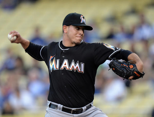 LOS ANGELES, CA - MAY 10: Jose Fernandez #16 of the Miami Marlins pitches during the first inning against the Los Angeles Dodgers at Dodger Stadium on May 10, 2013 in Los Angeles, California. (Photo by Harry How/Getty Images) ORG XMIT: 163493536