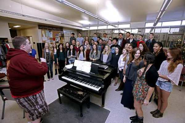 Burroughs High School choir teacher Brendan Jennings, left, leads his choir in a practice at the Burbank school on Thursday, May 9, 2013.
