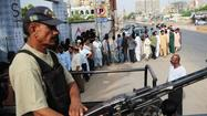 ISLAMABAD, Pakistan -- Pakistanis went to the polls Saturday to elect a new parliament amid continued violence marring the historic event, as militants detonated a bomb outside a liberal, anti-Taliban party's campaign office in the southern port city of Karachi, killing 10  people and injuring at least 15.