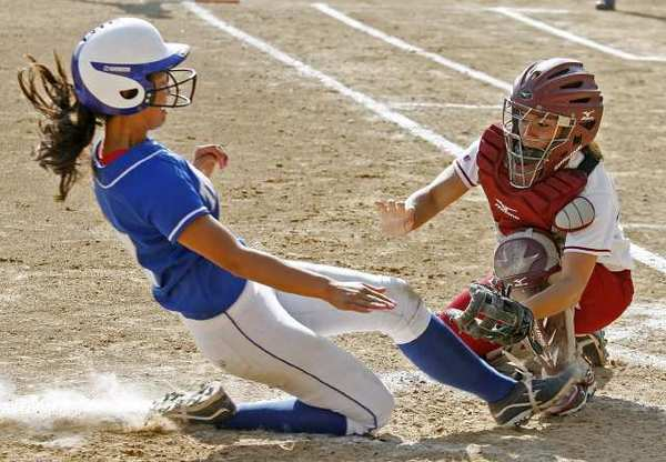 La Canada High catcher Olivia Lam drops down for the tag without the ball at home of San Marino's Lindsay Saldebar, who slid in safe in a Rio Hondo League softball game at La Canada High on Thursday, May 9, 2013. (Tim Berger/Staff Photographer)