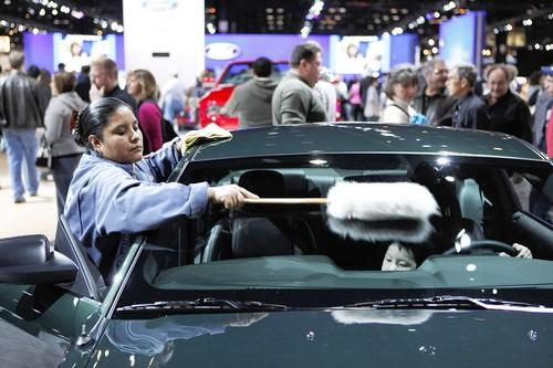 "Housekeeper Maria Jacinto brushes dust off a 2009 Ford Mustang during the <a class=""taxInlineTagLink"" id=""EVFES0000003"" title=""Chicago Auto Show"" href=""/topic/economy-business-finance/chicago-auto-show-EVFES0000003.topic"">Chicago Auto Show</a> at <a class=""taxInlineTagLink"" id=""PLCUL000061"" title=""McCormick Place"" href=""/topic/jobs-workplace/mccormick-place-PLCUL000061.topic"">McCormick Place</a> Sunday."