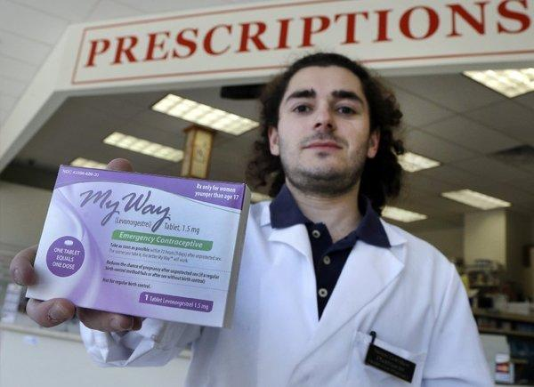 A federal judge has refused the Justice Department's request to issue a stay on his ruling requiring emergency contraception to be sold over the counter to customers of all ages. Pharmacist Simon Gorelikov holds a generic version of the pill.