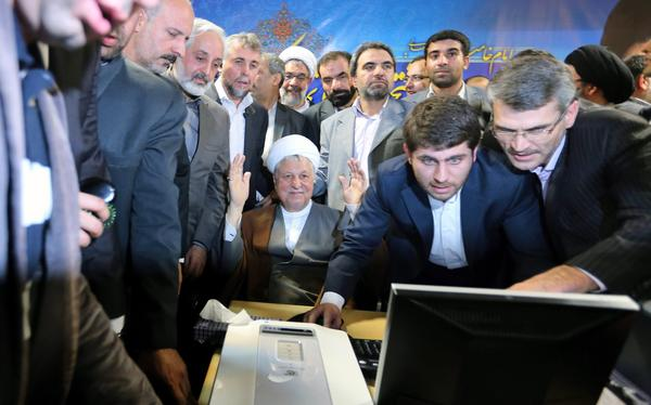 Iran's former president, Akbar Hashemi Rafsanjani, center, registers his candidacy for upcoming elections.