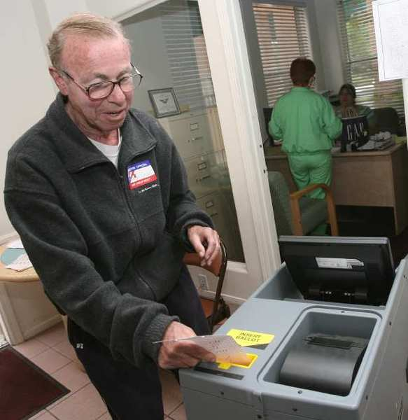 ARCHIVE PHOTO: Gary Cornell puts a ballot in the ballot machine at the San Rafael polling place Tuesday June 3, 2008 during the early morning hours. Cornell, a city commissioner who played a role in doling out millions in federal grants for public projects and social services, died Friday, May 10, 2013. He was 79.