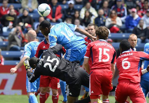 Fire goalkeeper Sean Johnson (25) makes a save against Philadelphia Union midfielder Amobi Okugo (14) during the first half at Toyota Park.
