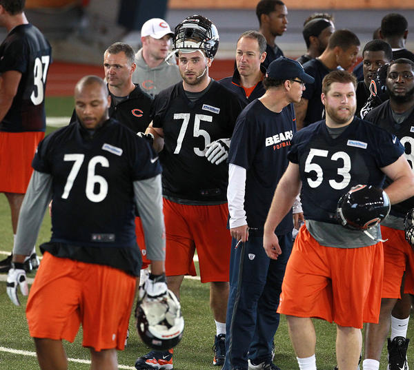 First round draft pick Kyle Long (75) makes his way to some scrimmage line drills.