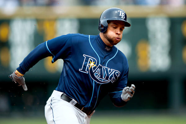 Tampa Bay Rays' James Loney rounds third base on his way to score a run against the Colorado Rockies.
