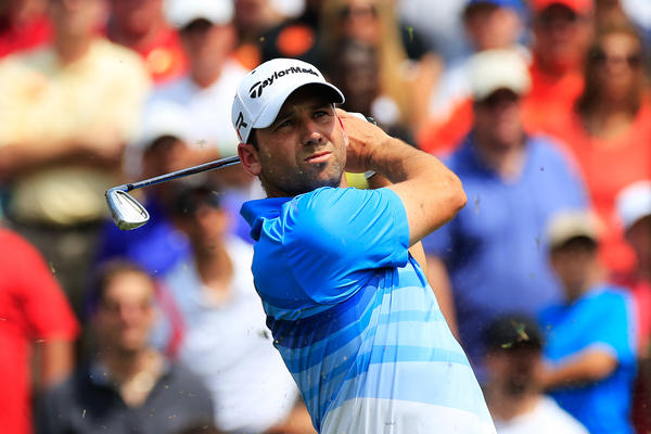 Sergio Garcia watches his shot from the third tee.