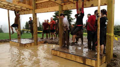 One of Seven Springs five new obstacles, The Hangover. It allows multiple people to cross over water via monkey bars at the same time. Many fell into the water below while others didnt even attempt to try it, they just walked throught the water to the other side.