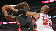 The implication was crystal clear: Bulls guard Nate Robinson felt that the Heat's LeBron James played a role in getting pushed to the floor by Nazr Mohammed in Game 3 Friday night.