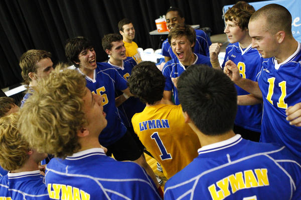 Lyman players celebrate their boys volleyball state championship victory over Bishop Moore at Silver Spurs Arena in Kissimmee on May 11, 2013.