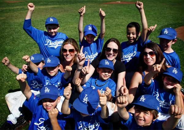 Mom coaches Tracy Chiovare, left, Jen Maljian and Claudia Chiovare pose with their Dodgers little league team following Saturday's game in Arcadia.