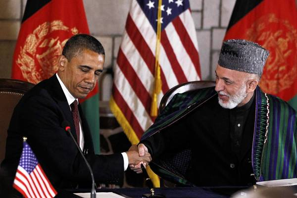President Obama and Afghan President Hamid Karzai shake hands on May 2, 2012, before signing a strategic partnership agreement in Kabul, Afghanistan. Diplomats met again in Kabul on Saturday to work on the pact outlining the U.S. commitment to Afghanistan after 2014.