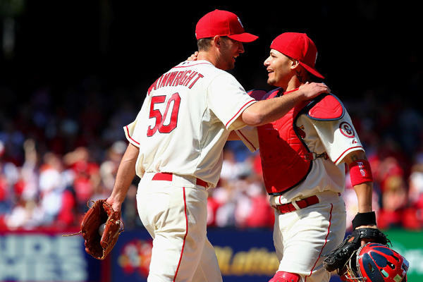 St. Louis Cardinals pitcher Adam Wainwright #and catcher Yadier Molina celebrate Wainwright's shutout of the Colorado Rockies on Saturday.