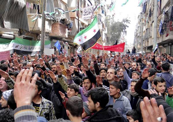 Syrian protesters in the city of Aleppo in March.