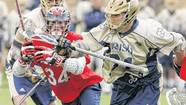 Notre Dame's Liam O'Connor, center, bobbles the ball during the first round of the NCAA men's lacrosse tournament match against Detroit on Saturday. At left is Detroit¿s Brandon Davenport.