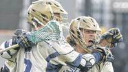Notre Dame's Matt Kavanagh (50), right, celebrates a score during the first round of the NCAA men's lacrosse tournament on Saturday, at Notre Dame.