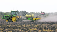 SOUTH BEND -- It was a sunny spring morning in March and farmers were gathered inside the Elkhart Community Building at the Elkhart County 4-H Fairgrounds for the Garber land auction.