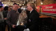 "More than two years after the Blackhawks brought the Stanley Cup trophy to Lottie's Pub, the NHL's most prized possession returned to the Bucktown bar to make a cameo on the NBC firefighter drama ""Chicago Fire."""