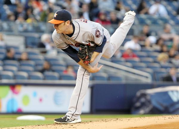 Astros pitcher Phil Humber throws a against the Yankees.