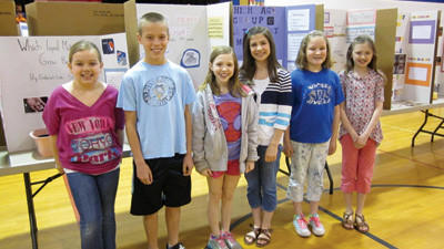 Fifth grade students at Windber Area Elementary School stand in front of projects on display at this year's science fair. They are Cassidy Betcher, Kobe Charney, Baylee Wojcik, Riley Hanley, Olivia Chappie and Trinity Krause.