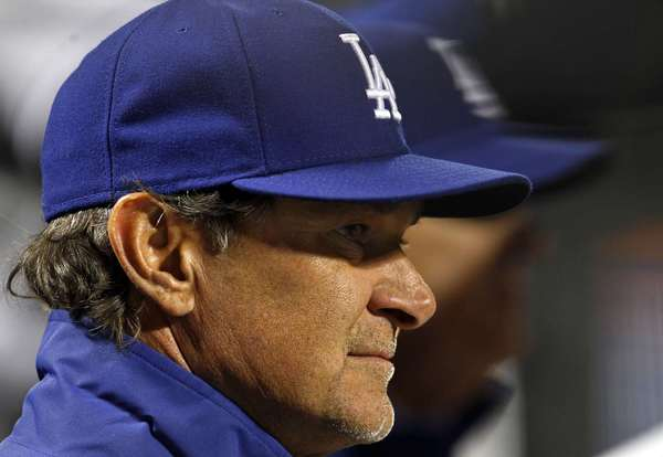 Los Angeles Dodgers manager Don Mattingly looks on against the New York Mets during the fifth inning of their MLB National League baseball game at CitiField in New York, April 23, 2013.REUTERS/Adam Hunger (UNITED STATES - Tags: SPORT BASEBALL HEADSHOT) ORG XMIT: NYM14
