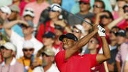 Tiger Woods wins The Players Championship, holding off Sergio Garcia and others