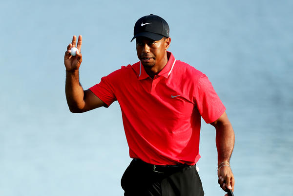 Tiger Woods waves to the crowd after finishing on the 18th green during the final round of the Players Championship.