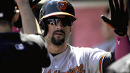 Orioles right fielder Nick Markakis, whose mother is a breast cancer survivor, decided not to use his specially made MaxBat black bat with a pink label Sunday. Players on the Orioles and Twins used various pink apparel and equipment on Mother's Day as part of a MLB campaign promoting breast cancer awareness.