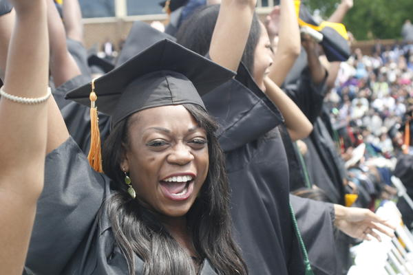 A Hampton University graduate celebrates during commencement ceremonies on Sunday.