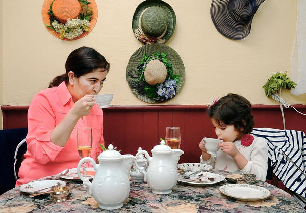 Rajia Sebbahi, left, and her daughter, Layla Alsaleh, have a cup of tea at Sereni-Tea Room in Funkstown on Sunday.