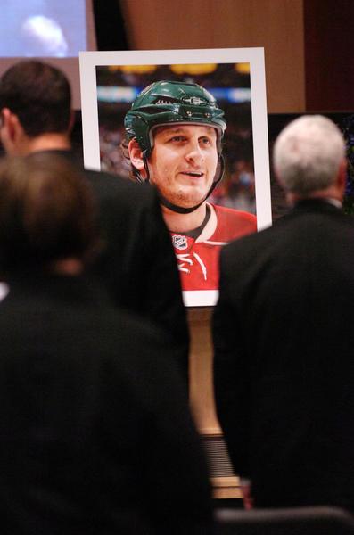 Mourners stand during the funeral of Derek Boogaard in Regina, Saskatchewan, Canada.