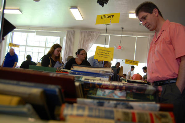 Tony Guarriello of Chambersburg, Pa., peruses the selection Sunday at the Friends of Legal Services book sale in Chambersburg.