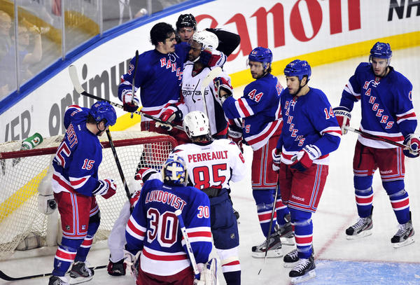 The Rangers' Brian Boyle head locks the Capitals' Joel Ward after a whistle during the third period.