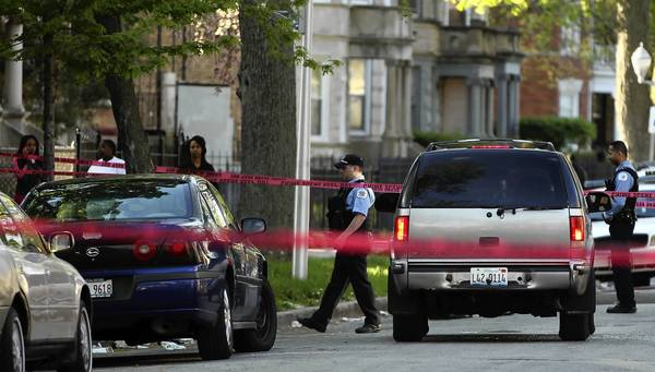 Police investigate a shooting in the 6500 block of South Green in Chicago. Ronald A. Baskin, great-nephew of community activist Hal Baskin, was shot killed Sunday afternoon.