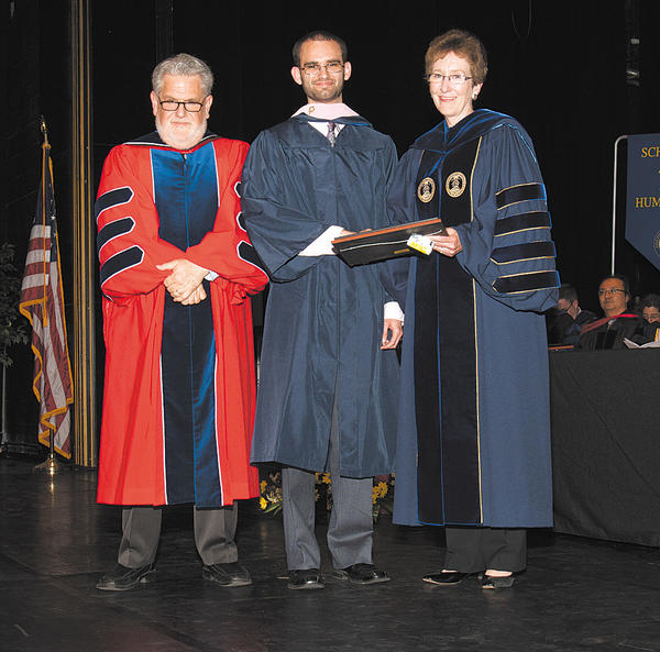 Nathan James Arch, center, is shown with Christopher Ames, vice president for academic affairs, and Suzanne Shipley, president of Shepherd University.