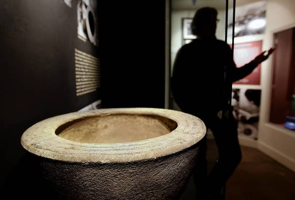 Michael De Marsche, executive director of the Catalina Island Museum, stands near an urn found by Ralph Glidden that's part of the new Glidden exhibit at the museum in Avalon. Bones are not part of the exhibit.