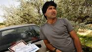 Afghans on U.S. bases losing jobs after years of devoted service