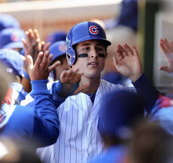 Anthony Rizzo after scoring ahead of Luis Valbuena on Nate Schierholtz's double in the 4th against the Cardinals.