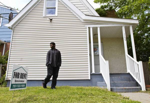 Tre'von Williams takes a first look around a house his family is considering renting in a Southeast Newport News neighborhood.